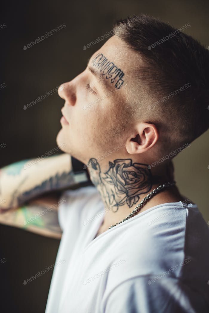 Trendy young man in tattoos