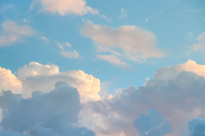 blue sky with sunset clouds in autumn evening
