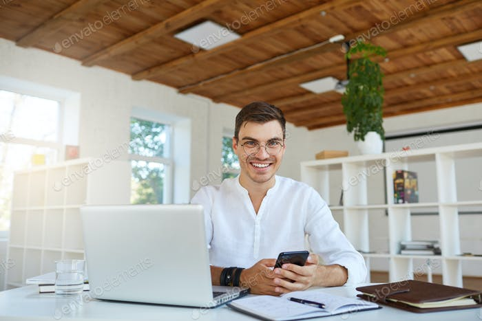 attractive young businessman wears white shirt and spectacles