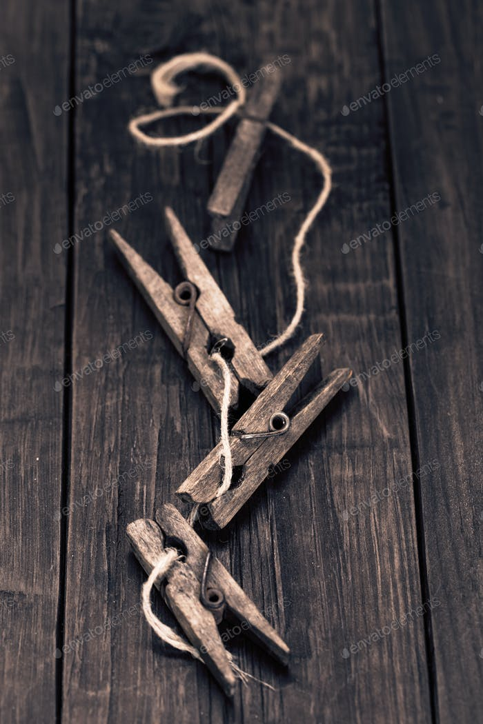 Old wooden pegs on wooden table