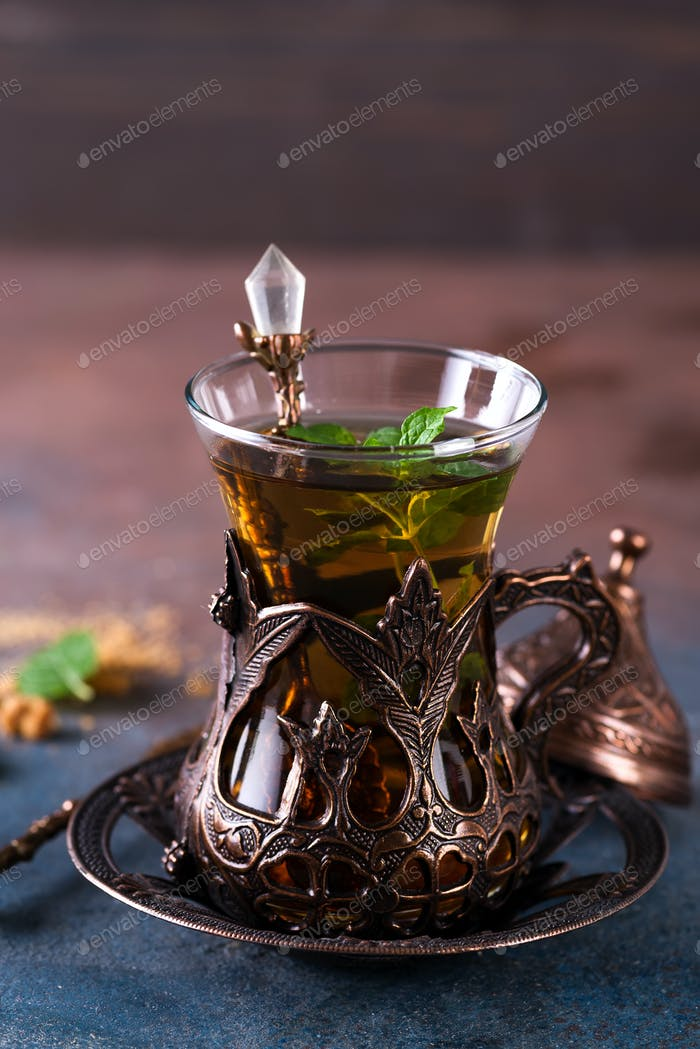 Turkish tea with mint in a traditional cups on the stone background