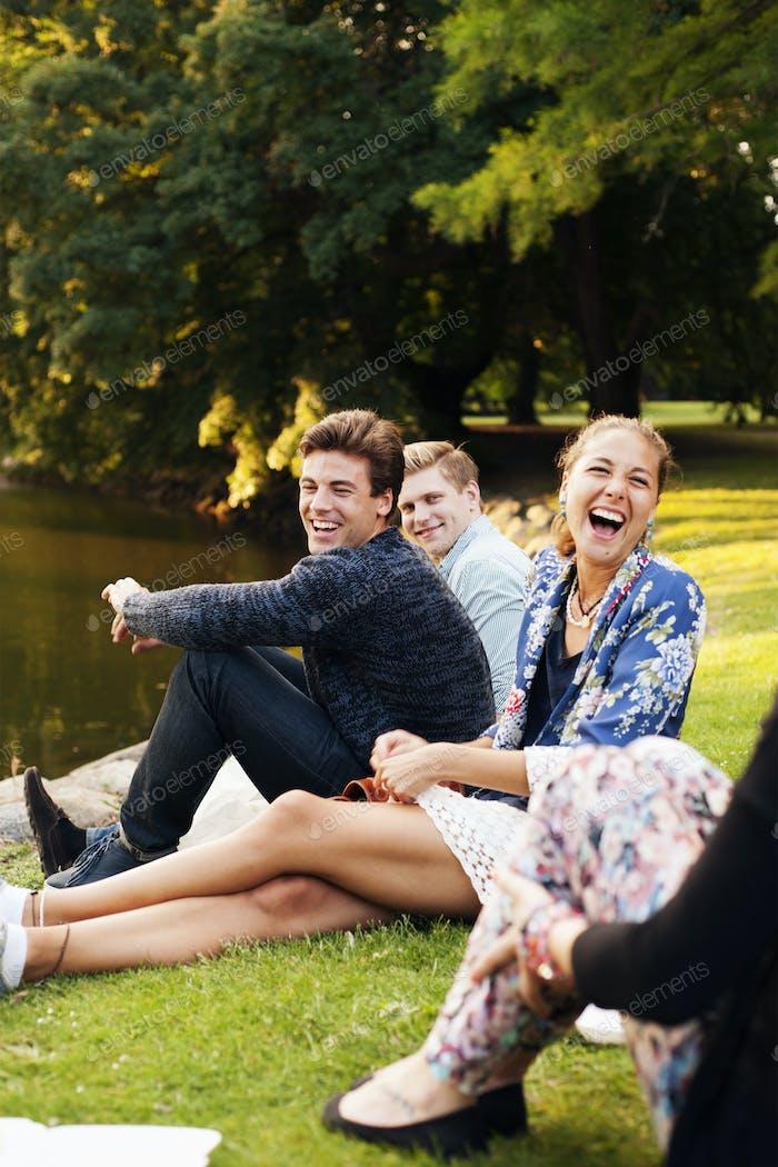 Happy friends enjoying at riverbank
