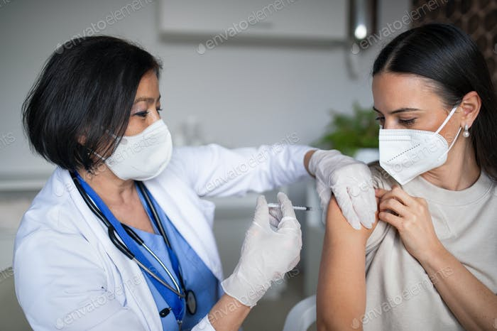 Woman getting vaccinated in hospital, coronavirus and vaccination concept