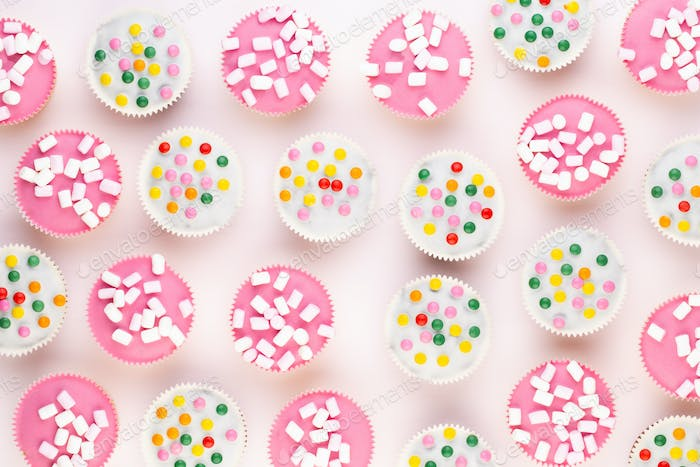 Colorful cupcakes on a white background.