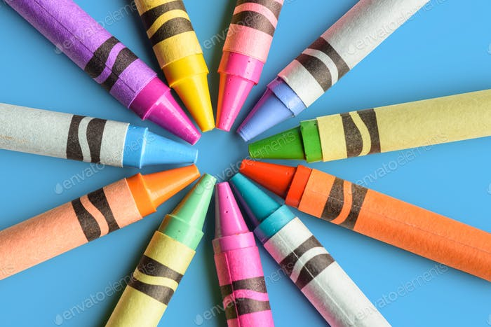 Close up of colorful and pastel crayons
