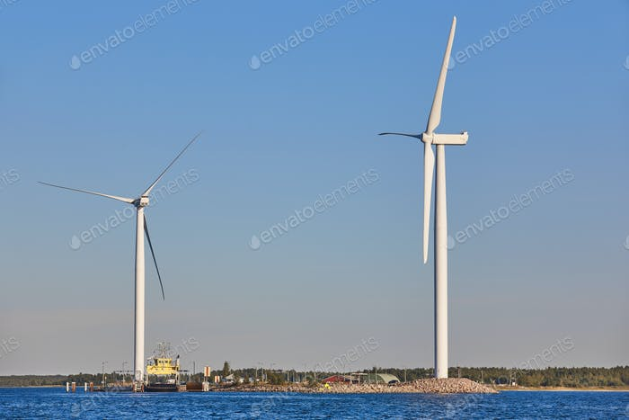 Windmills in the baltic sea. Renewable clean and green energy. Finland
