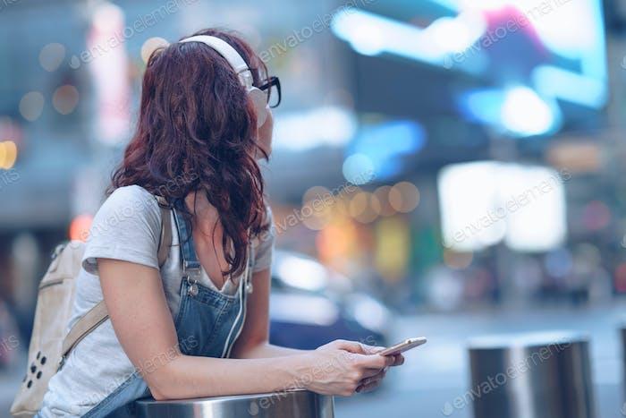Girl with headphones in New York