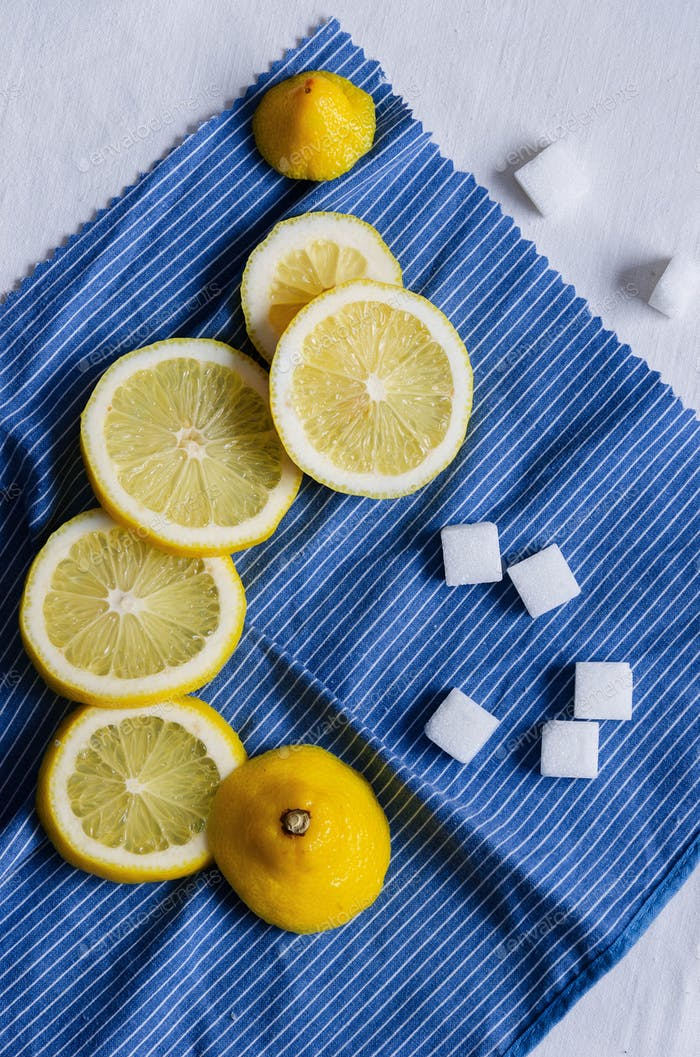 Slices of lemons and sugar cubes
