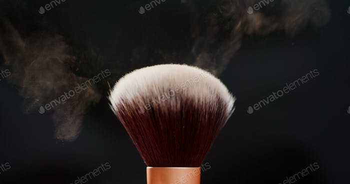 Two Make up brushes with powder