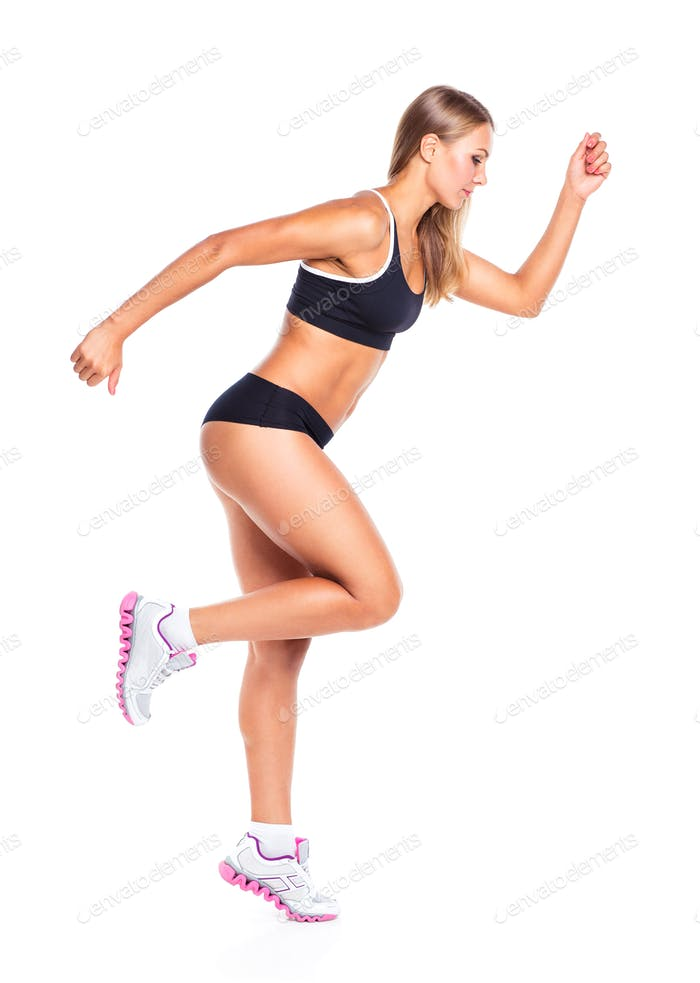Young athletic girl on white