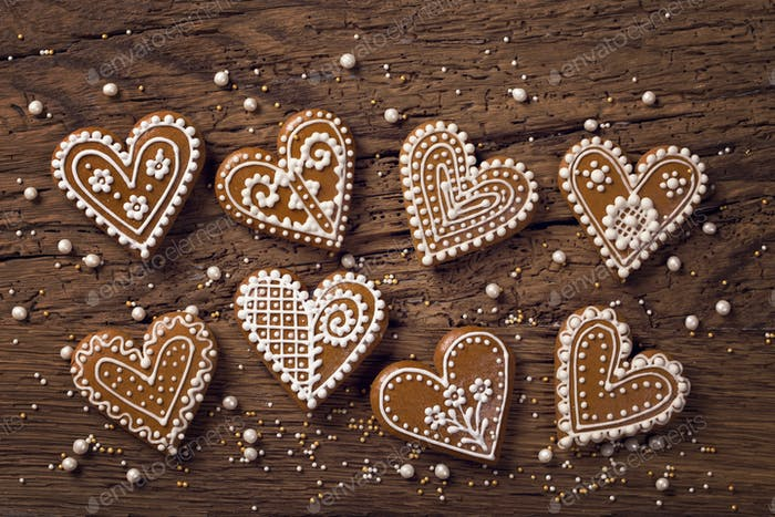 Gingerbread home cookies on a wooden brown background