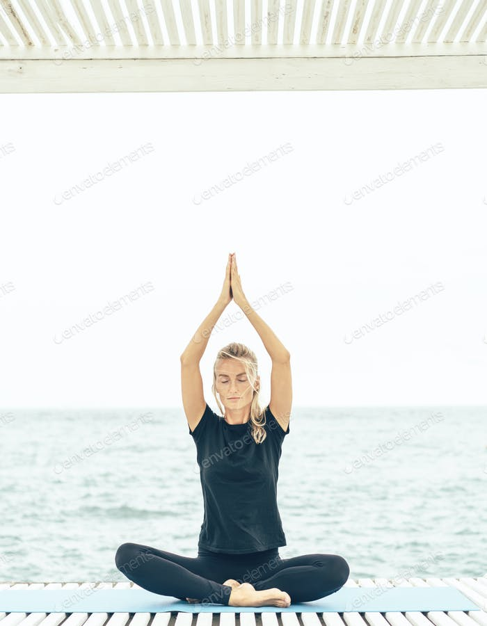 Portrait of gorgeous young woman practicing yoga outdoor. Beautiful girl practice asana.
