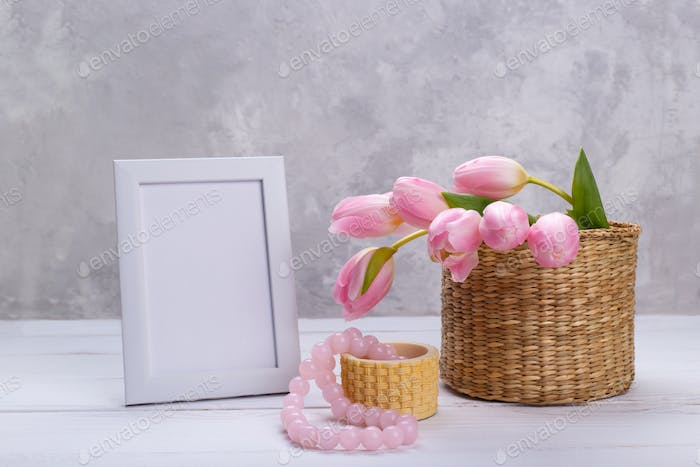 Empty picture frame and tulips
