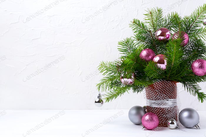 Christmas centerpiece with pink and silver baubles, copy space