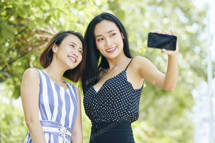 Selfie portrait of women outdoors