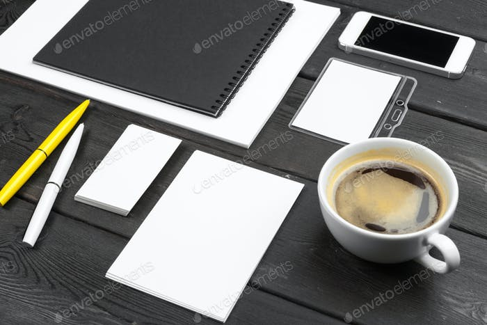 Blank corporate stationery set on wood table background. Branding mock up.