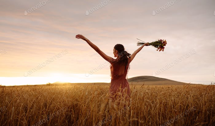 nature; free; freedom; farm; woman; relaxation; strolling; dreamy; sunset; backlit; summer