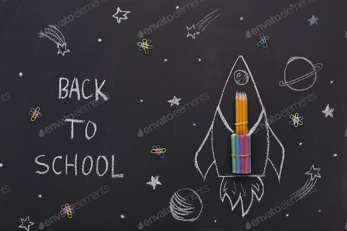 Chalk painted space rocket with pencils inside