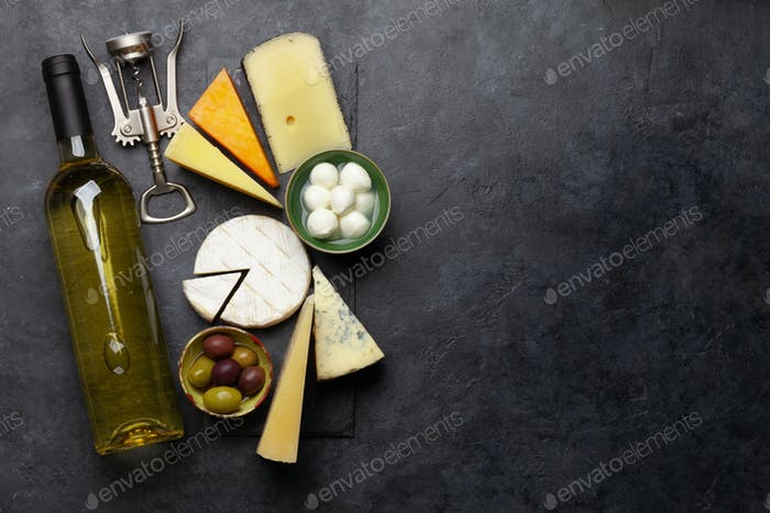 Various cheese, olives and white wine