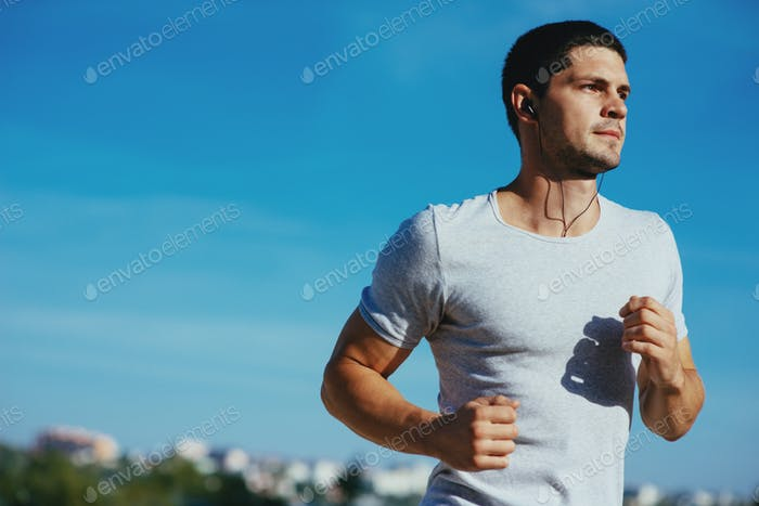 Attractive strong athlete running