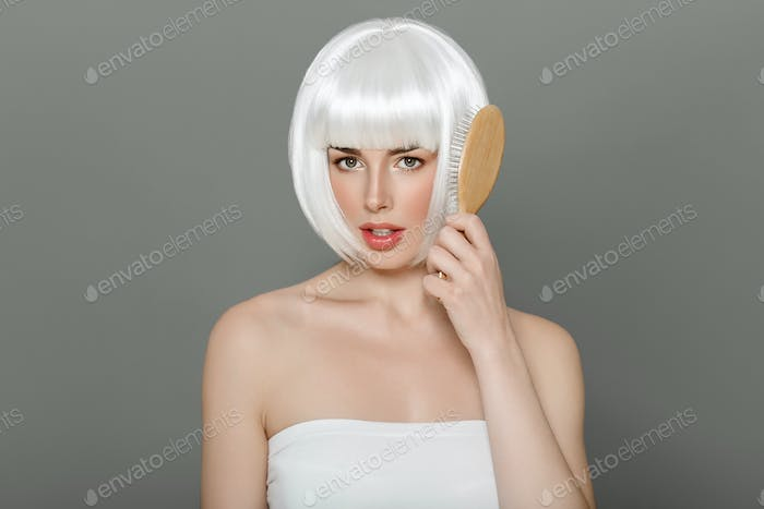 Short blonde hair woman bob platinum hairstyle over gray background