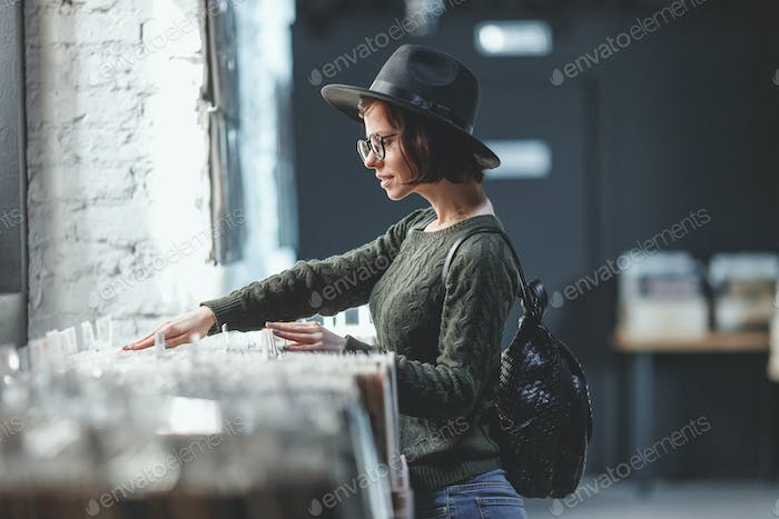 Young girl browsing records