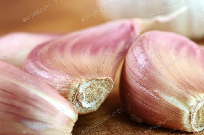 Organic garlic on wooden cutting board