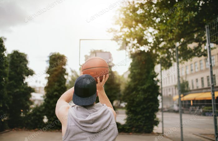 Streetball player shoots basket