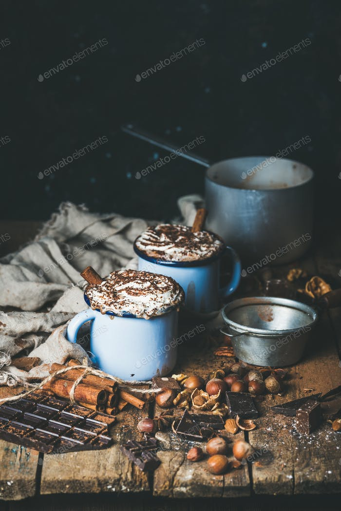 Hot chocolate with whipped cream, different nuts and spices
