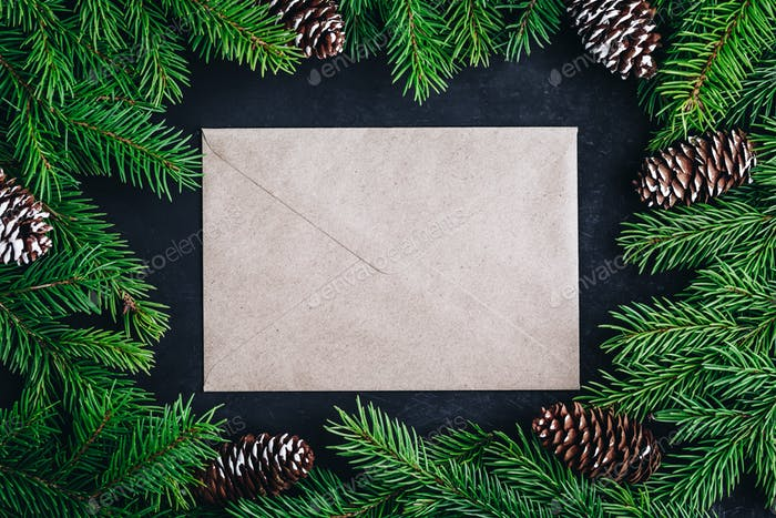 Christmas festive layout background with spruce branches with cones and paper card note