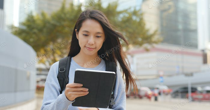Woman use of digital tablet computer at outdoor