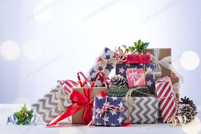 Christmas gift boxes on blue bokeh background