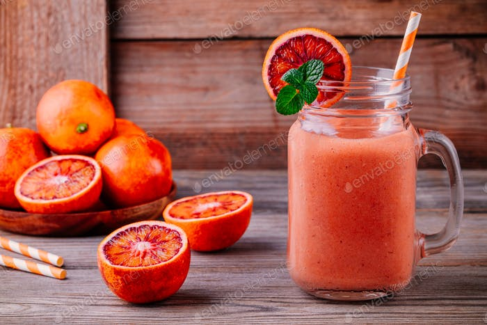Fresh smoothie with  banana, blood oranges and mint in a mason jar