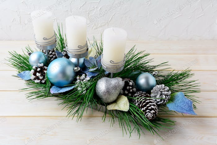 Christmas background with blue ornaments decorated candleholder