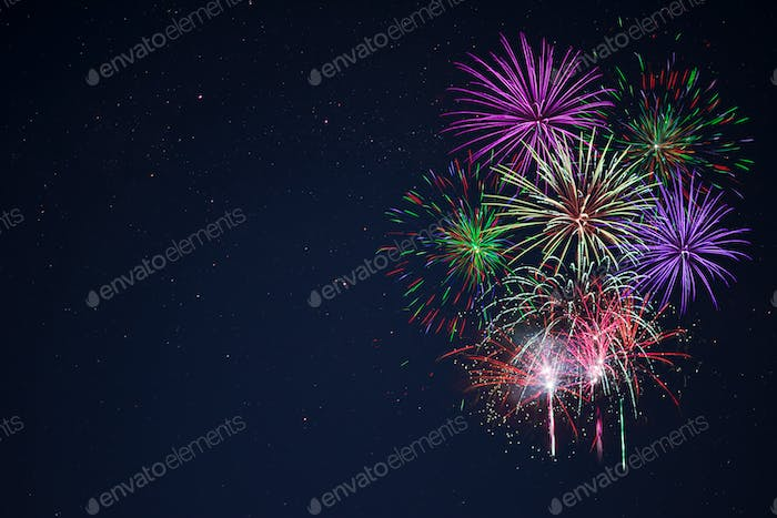 Purple lilac red green celebration fireworks copy space.