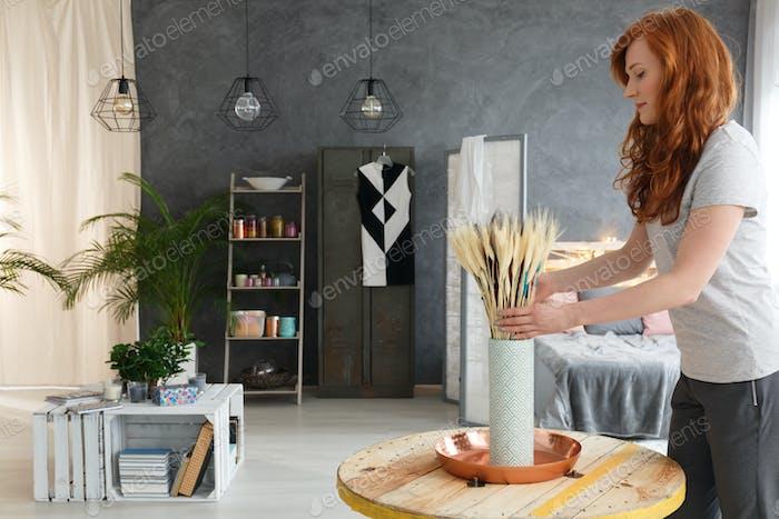 Woman decorating apartment
