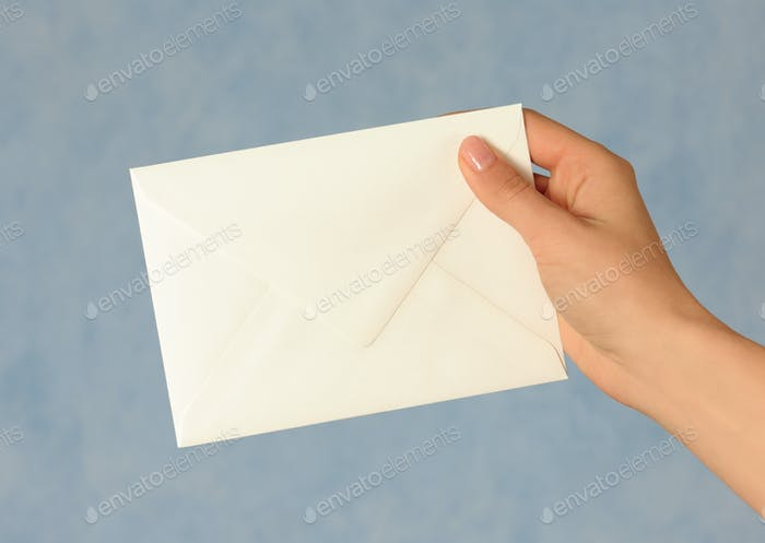 Hand with white envelope