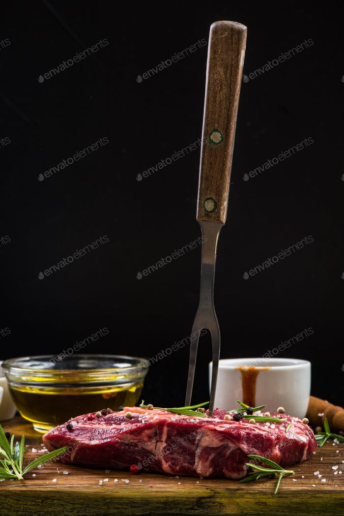 Beef steak with BBQ fork, copy space