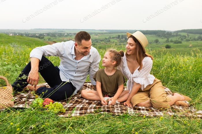Happy family spending time together in the meadow