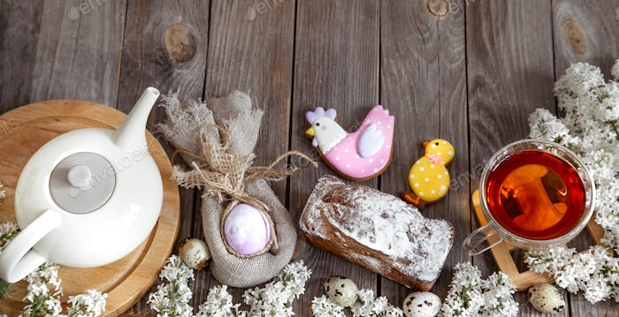 Easter holiday dessert table with pastries and cookies .