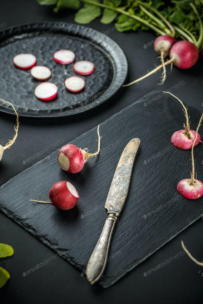 Sliced and whole fresh radishes