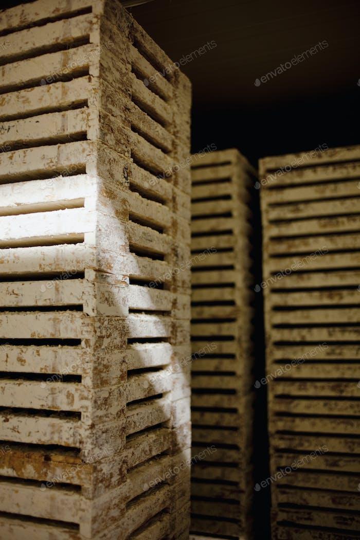 Weathered crates in dark room