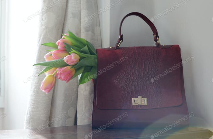 briefcase with pink tulips