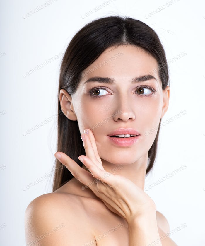 Portrait of beautiful young brunette woman with clean face.