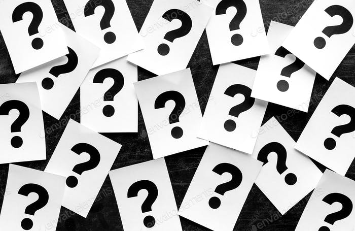 Bold black question marks on paper cards