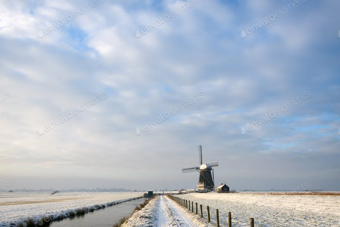 Winter landscape with a windmill under a nice sky