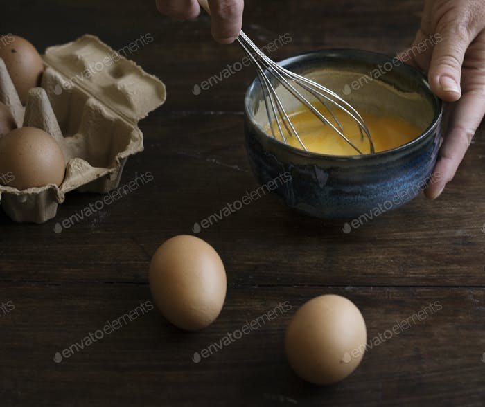 Woman whisking eggs food photography recipe idea
