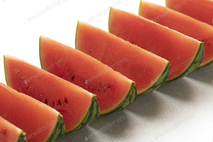 Row of red watermelon wedges