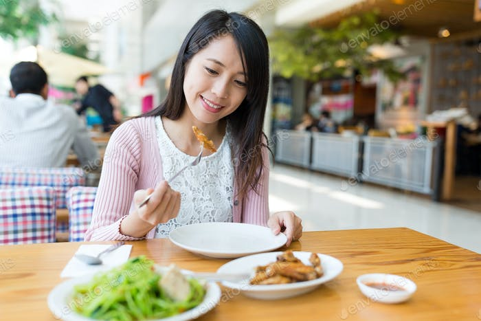 Woman having meal at restaurant