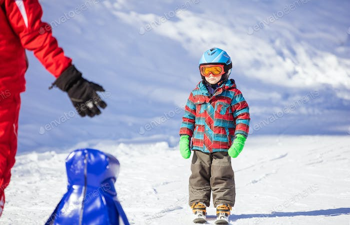 Young skier looking at ski instructor